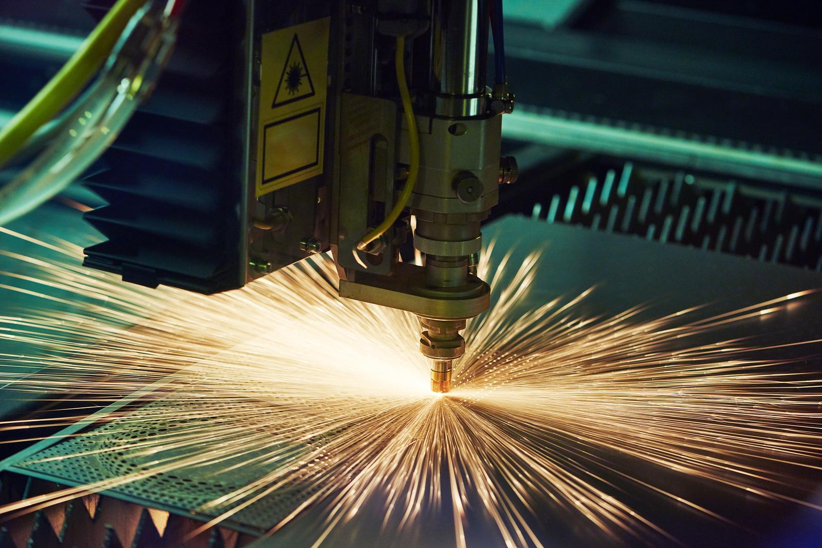 Machine cutting through metal