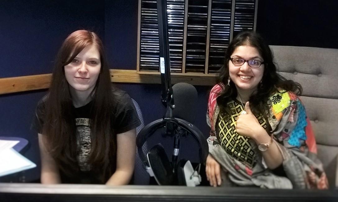 Two people with headphones in recording studio