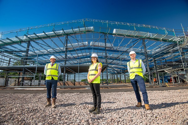 Pictured at the Exhall3 site being developed by The Wigley Group are Claire Lynch, head of group governance and development, with left, Charlie Brooks, construction director, and right, James Ellerington, operations director