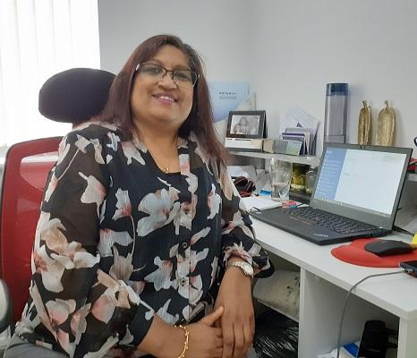 Citizen panel member, Punita Bhakta at her desk