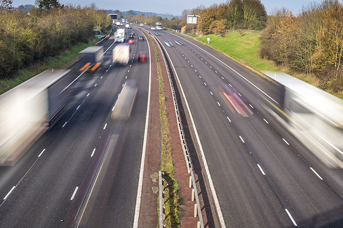 Blurred vehicles driving on motorway