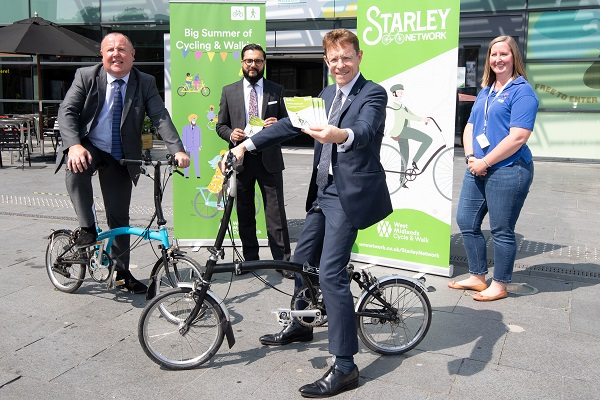 L-R Cllr Jim O'Boyle, Coventry City Council cabinet member for jobs and regeneration, Sandeep Shingadia, TfWM's director of development and delivery, Mayor of the West Midlands Andy Street and Megan Nass, curator of cycles and transport objects at Coven