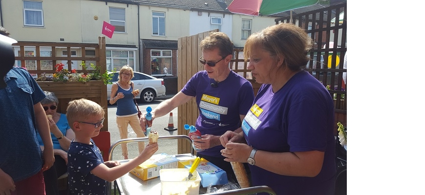 Mayor of the West Midlands Andy Street is pictured serving ice cream during last year's Mayor's Community Weekend