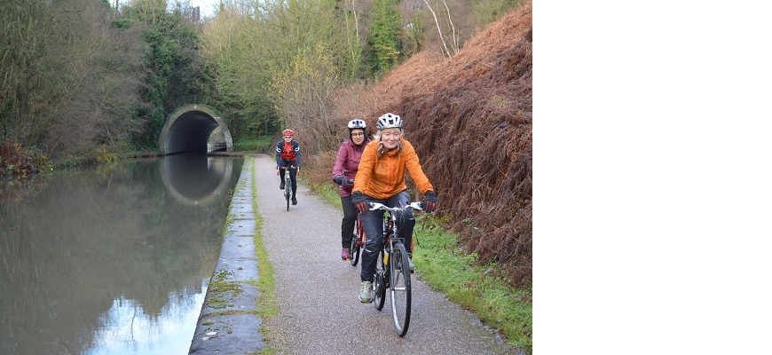 Locals cycle along a river