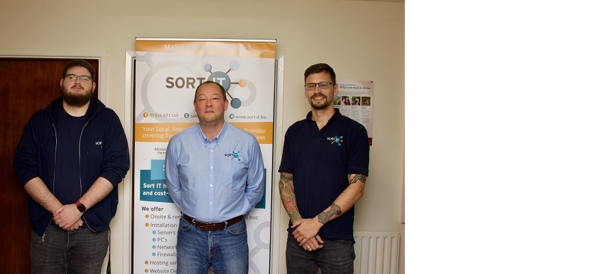 Apprentices Ben Steele (left) and Laurence Vincent-Hunt (right) with Sort IT managing director Nick Marsden