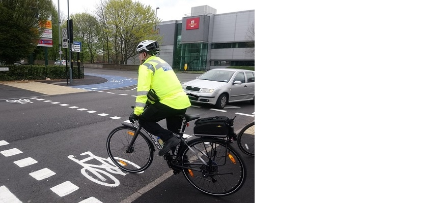 A police officer cycling