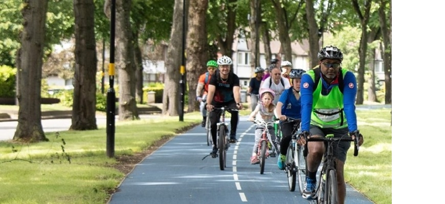 Group of cyclists of all ages