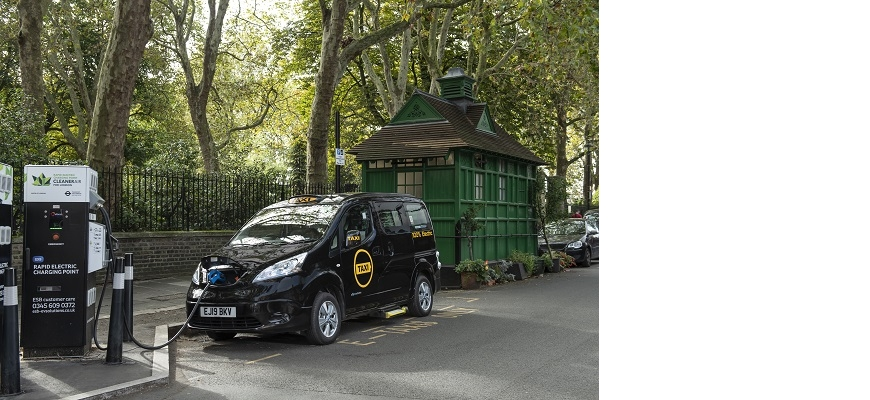 An electric taxi at a charging station