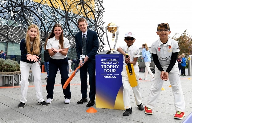 Andy Street with student cricketers
