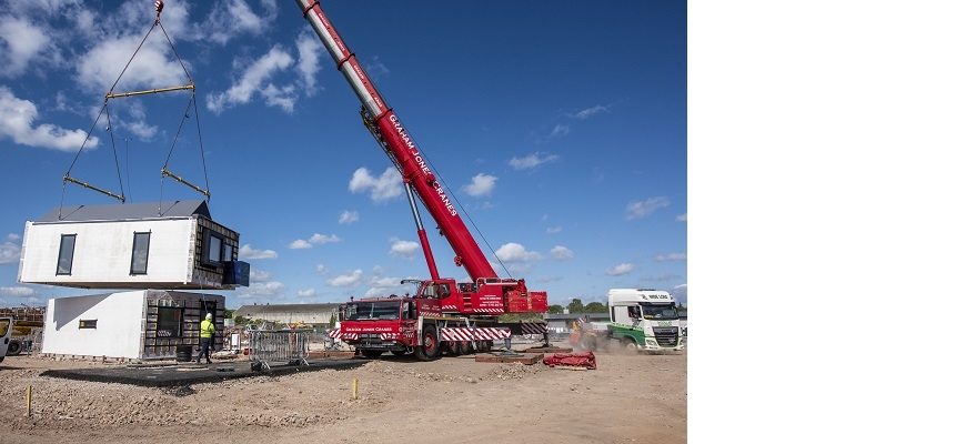 A modular home is craned in on-site in Birmingham