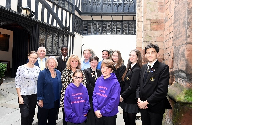 Back from the left, Lizzie Mara and members of the Coventry BID team with students from West Coventry Academy, Stivichall Primary School and Howes Primary School