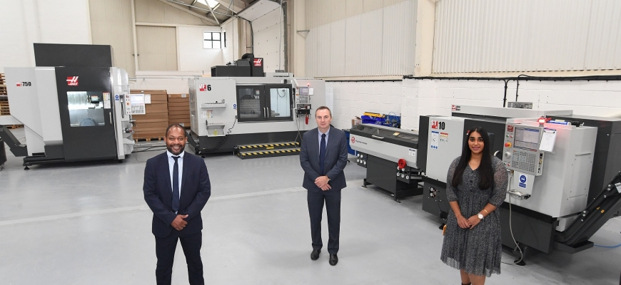 From left – Martin Nwangwa, Rob Coles, and Kierandeep Bal next to the new CMC machines at Opus International