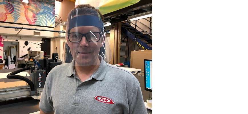 Phil Skinner, a director at PSW Paper & Print wearing PPE