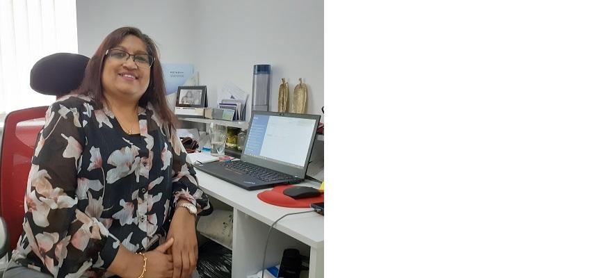 Punita Bhakta at her desk