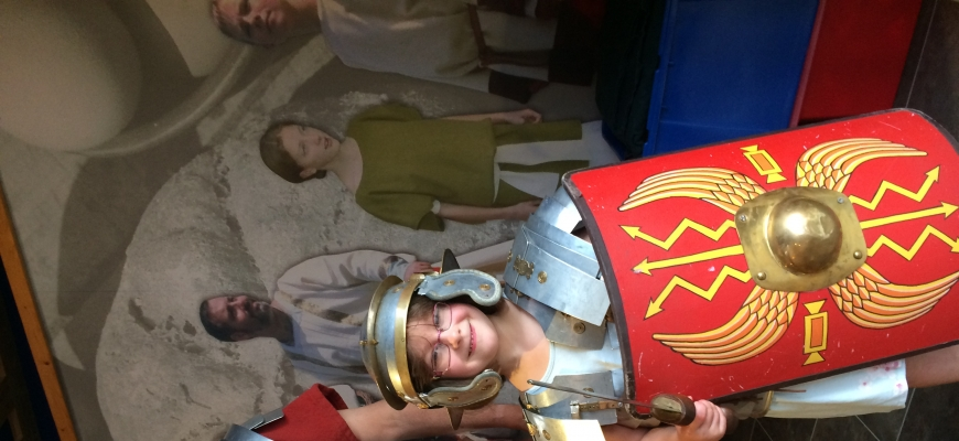 A man and little girl in Roman costume