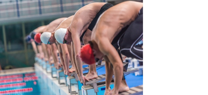Competitive swimmers on blocks