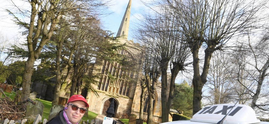 Kevin Jones with his cab outside Holy Trinity Church in Stratford