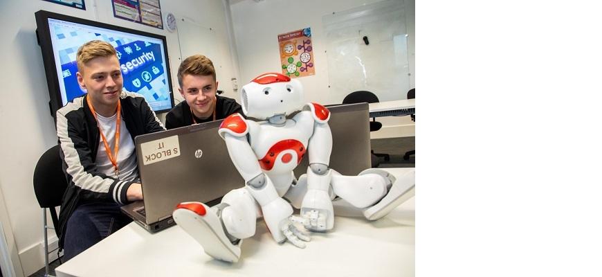 Digital Tech students work on a laptop